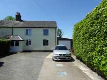 Deceptively spacious three double bedroom house with extensive rural views...